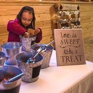 Love is sweet, take a treat sign.